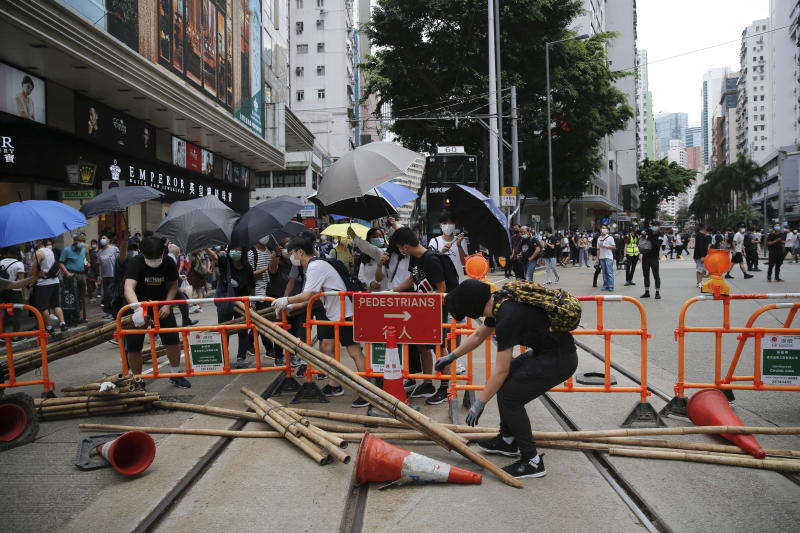 Protesters set up blockades during a protest against Beijing's national security legislation in Hong Kong, Sunday, May 24, 2020. Hundreds of protesters took to the streets Sunday to march against China's proposed tough national security legislation for the city. (AP Photo/Kin Cheung)