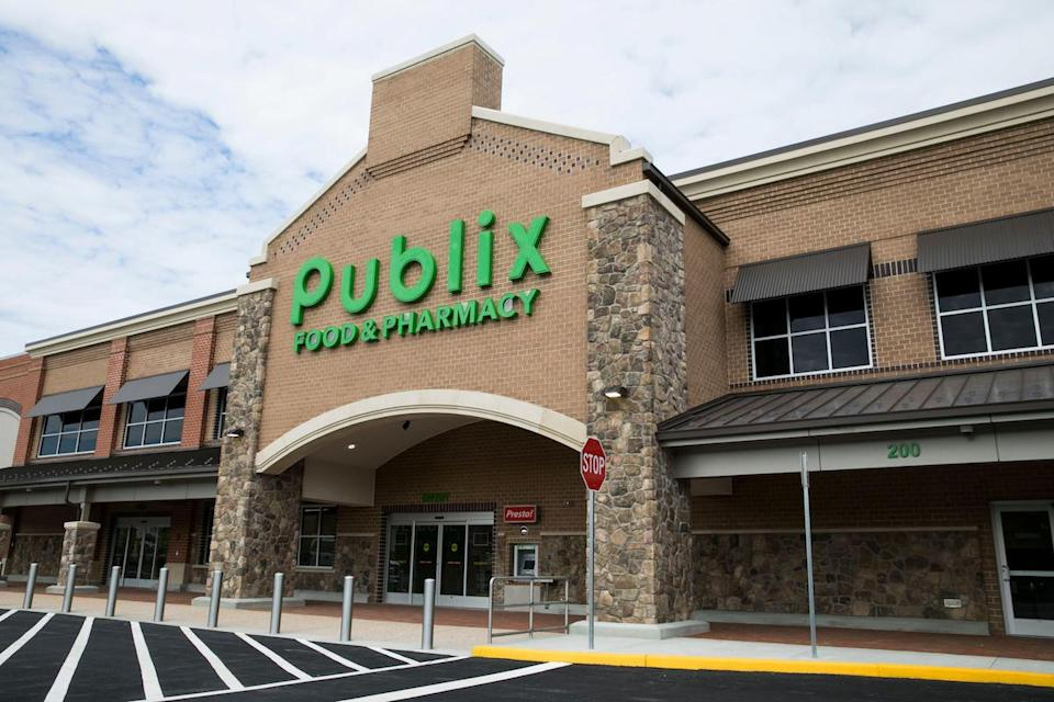 A logo sign outside of a Publix Super Markets retail grocery store location in Midlothian, Virginia
