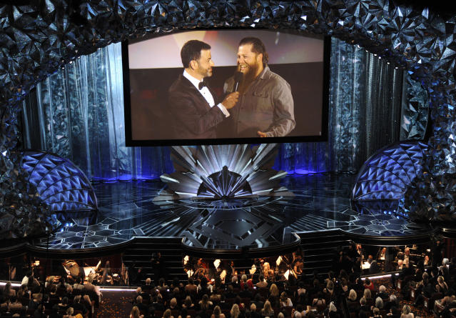 Host Jimmy Kimmel, left, speaks with a member of the movie theater audience on screen via satellite at the Oscars. (Photo: Chris Pizzello/Invision/AP)