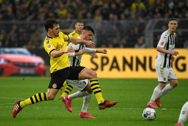 "Key Dortmund defender Mats Hummels is ""99 precent"" ready to face former club Bayern Munich on Tuesday after an Achilles tendon knock. (AFP Photo/Ina FASSBENDER)"