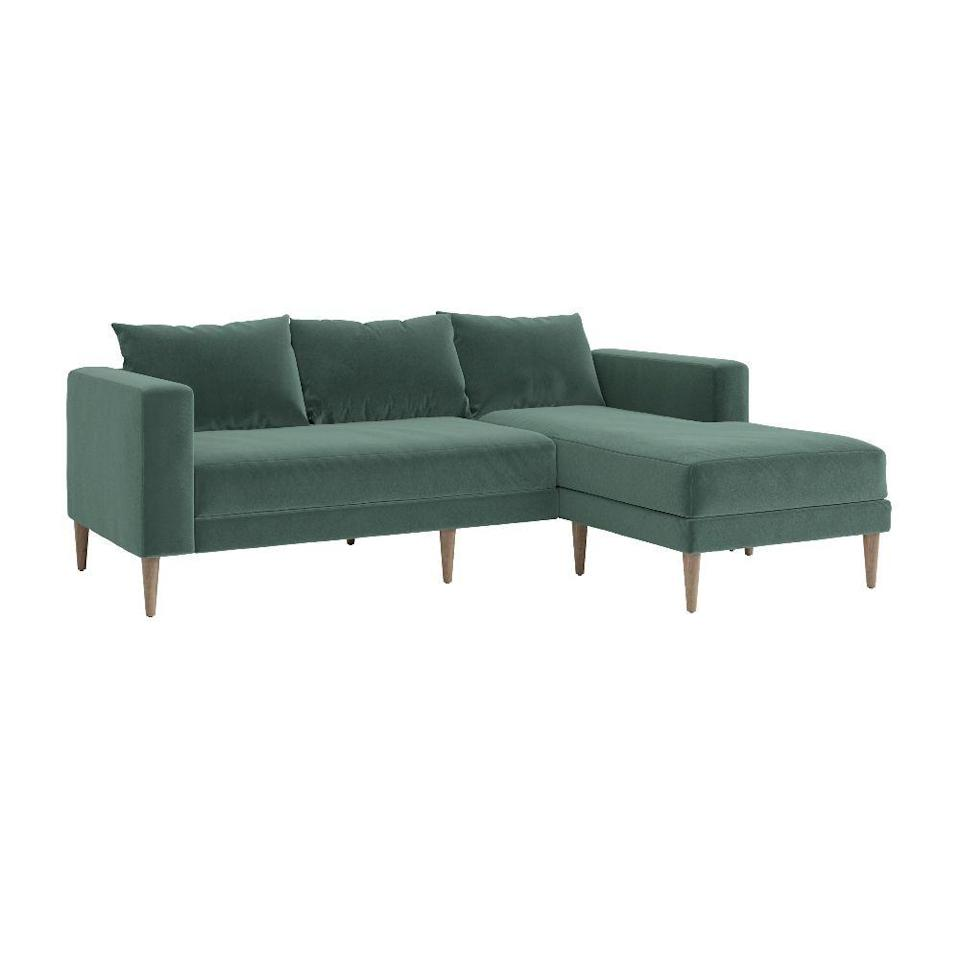 "<p>sabai.design</p><p><strong>$1395.00</strong></p><p><a href=""https://sabai.design/collections/seating/products/the-essential-sectional-last?variant=36208124297376"" rel=""nofollow noopener"" target=""_blank"" data-ylk=""slk:BUY NOW"" class=""link rapid-noclick-resp"">BUY NOW</a></p><p>Reviewers praise this sleek, stylish sectional for its comfort (thanks to its wide arms and all the extra legroom its convertible chaise has to offer) but it's got another perk, too: it's ethically and sustainably made from recycled water bottles, making it an eco-friendly pick, too. </p>"