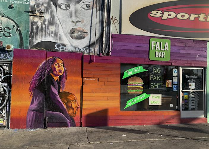 "This mural by Joshua ""Prophet Josh"" McCadney, called ""The Dreamer and the Believer,"" is one of two Kobe murals he painted on Melrose Avenue, this one is at the Fala Bar, 7751 Melrose Avenue. <span class=""copyright"">(@kobemural Instagram)</span>"