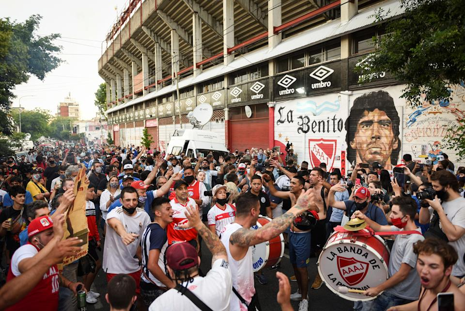 <p>People gather to mourn the death of Diego Maradona outside the Diego Armando Maradona stadium in Buenos Aires</p>REUTERS