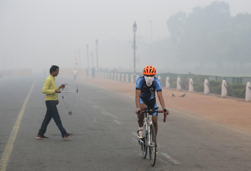 A cyclist pedals through the morning smog Diwali festival, in New Delhi, India, Friday, Oct. 20, 2017. Environmental pollution - from filthy air to contaminated water - is killing more people every year than all war and violence in the world. One out of every six premature deaths in the world in 2015 - about 9 million - could be attributed to disease from toxic exposure, according to a major study released Thursday, Oct. 19, 2017 in The Lancet medical journal. (AP Photo/Manish Swarup)