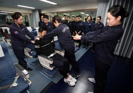 Cabin crews attend a training session on how to manage in-flight disturbances in Seoul, South Korea, December 27, 2016.   Shin Joon-hee/Yonhap via REUTERS