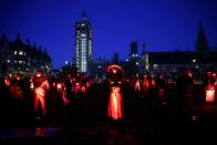 Demonstrators from the West End Campaign protest on parliament square, calling for more funding for the performing arts, amid the coronavirus disease (COVID-19) outbreak, in London