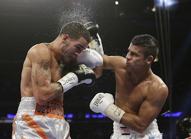 Javier Maciel, of Argentina, right, punches Jorge Melendez, of Puerto Rico, during the fourth round of a USNBC Super Welterweight Title boxing match Saturday, June 7, 2014, in New York. Maciel won the fight. (AP Photo/Frank Franklin II)