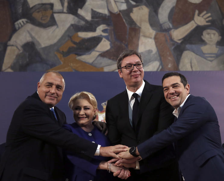 Serbian President Aleksandar Vucic, second right, poses with Romanian Prime Minister Viorica Dancila, second left, Bulgarian Prime Minister Boyko Borisov, left, and Greece's Prime Minister Alexis Tsipras after talks in Belgrade, Serbia, Saturday, Dec. 22, 2018. The leaders of Serbia, Romania, Bulgaria and Greece met here on Saturday discussing economic cooperation. (AP Photo/Darko Vojinovic)