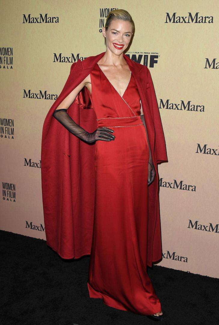 The actress demonstrated the art of tonal dressing in a fiery red dress, matching coat and sheer gloves - red carpet perfection if you ask us. <em>[Photo: Getty]</em>