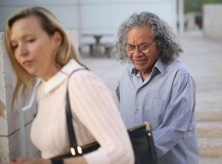 The billionaire founder of Insys Therapeutics Inc. John Kapoor, exits the federal court house with an unidentified woman after a bail hearing in Phoenix, Arizona , U.S., October 27, 2017.  REUTERS/Conor Ralph