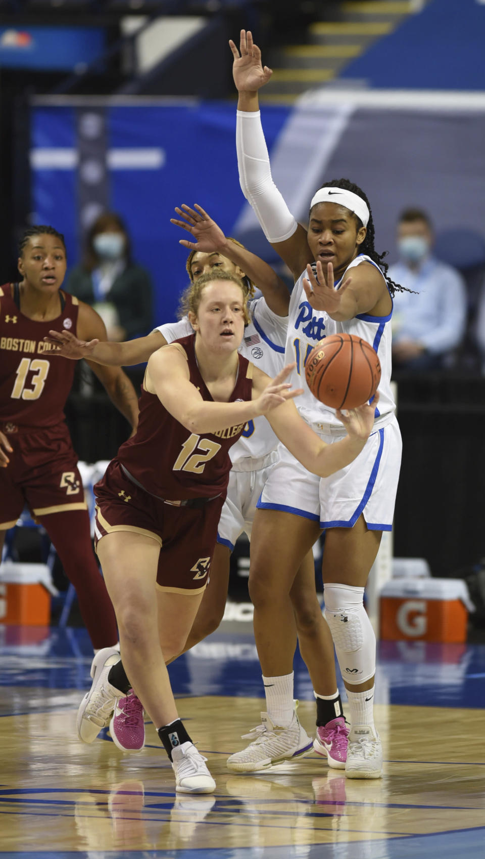 Boston College's Ally VanTimmeren, left, looks for help as she is guarded by Pittsburgh's Cynthia Ezeja in the opening round of the Atlantic Coast Conference Tournament, Wednesday, March 3, 2021, at the Greensboro Coliseum in Greensboro, N.C. (Walt Unks/The Winston-Salem Journal via AP)