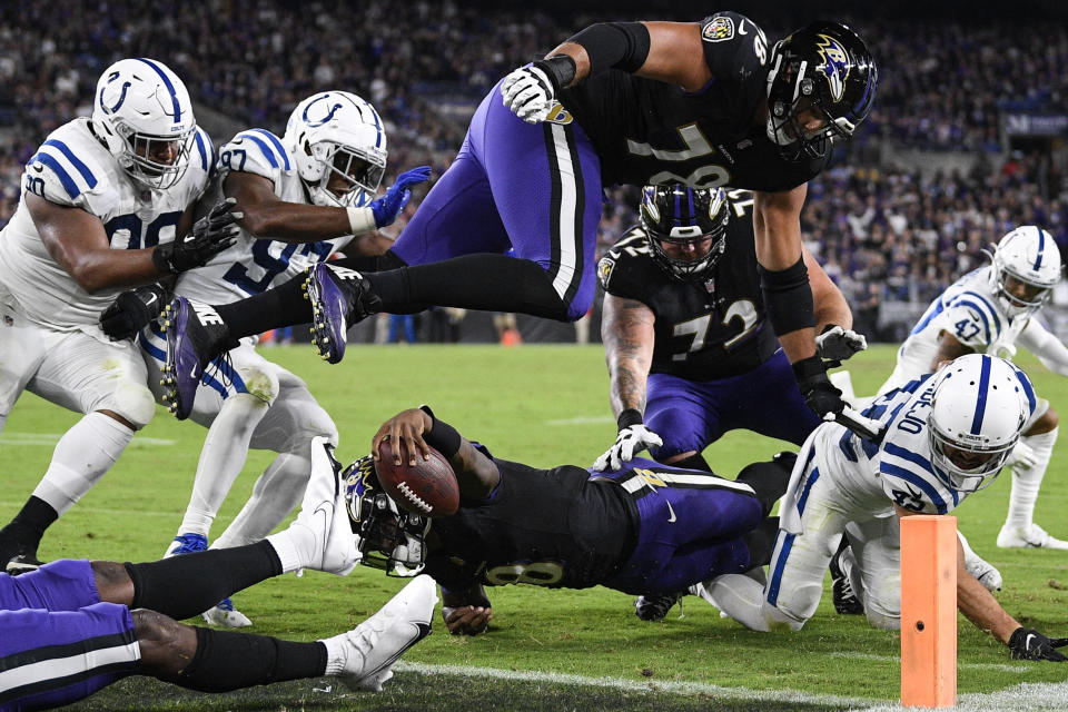 Baltimore Ravens quarterback Lamar Jackson (8) stretches for a failed attempt for a 2-point conversion during the second half of an NFL football game against the Indianapolis Colts, Monday, Oct. 11, 2021, in Baltimore. (AP Photo/Nick Wass)