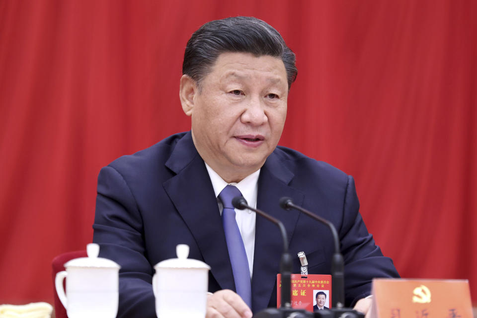 """In this photo released by Xinhua News Agency, Chinese President Xi Jinping, also general secretary of the Communist Party of China (CPC) Central Committee, speaks during fifth plenary session of the 19th CPC Central Committee in Beijing on Oct 29, 2020. China's leaders are vowing to make their country a self-reliant """"technology power"""" after a meeting to draft a development blueprint for the state-dominated economy over the next five years. (Ju Peng/Xinhua via AP)"""
