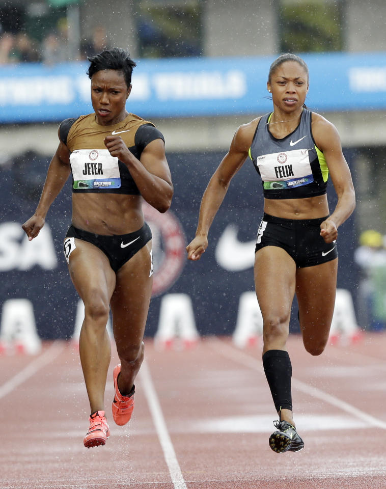Carmelita Jeter and Allyson Felix compete in the women's 100m semi finals at the U.S. Olympic Track and Field Trials Saturday, June 23, 2012, in Eugene, Ore. (AP Photo/Eric Gay)