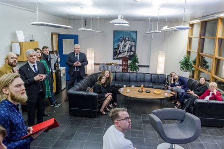 Party representatives are seen after the first results of the parliementary elections in Iceland