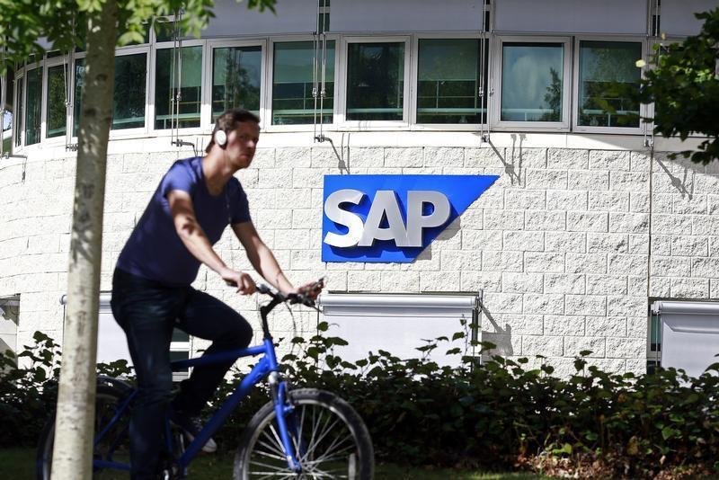 A man cycles past the SAP logo at its offices in the CityWest complex, Dublin