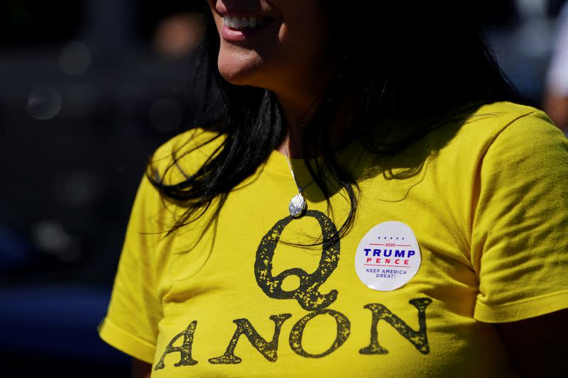 FILE PHOTO: A supporter of U.S. President Donald Trump wears a QAnon shirt after participating in a caravan convoy circuit in U.S. state of Georgia