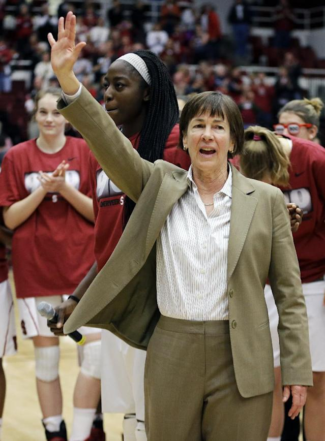 Stanford coach Tara VanDerveer waves to fans after a ceremony in recognition of her 900 career wins after an NCAA college basketball game against Gonzaga, Saturday, Dec. 14, 2013, in Stanford, Calif. (AP Photo/Ben Margot)