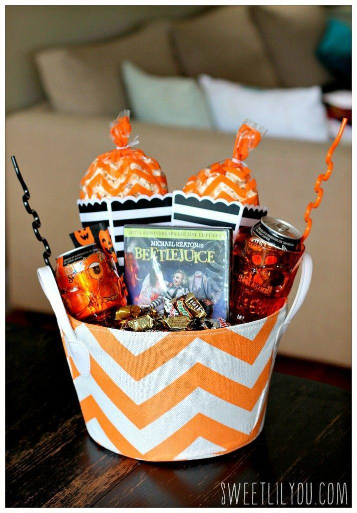 """<p>A <a href=""""https://www.goodhousekeeping.com/holidays/halloween-ideas/g2661/halloween-movies/"""" rel=""""nofollow noopener"""" target=""""_blank"""" data-ylk=""""slk:family-friendly Halloween movie"""" class=""""link rapid-noclick-resp"""">family-friendly Halloween movie</a>, some popcorn, some candy and a fun drink — all the ingredients you need for a perfect night in can be found in one basket. </p><p><a href=""""https://sweetlilyou.com/movie-night-boo-kit-booitforward-ad/"""" rel=""""nofollow noopener"""" target=""""_blank"""" data-ylk=""""slk:See more at Sweet Lil You »"""" class=""""link rapid-noclick-resp""""><em>See more at Sweet Lil You »</em></a></p>"""
