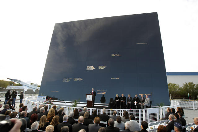 Stephen Feldman, at podium, president and CEO of the Astronauts Memorial Foundation speaks in front of the memorial during a rememberance ceremony to mark the 25th Anniversary of space shuttle Challenger explosion at the Kennedy Space Center visitor complex in Cape Canaveral, Fla., Friday, Jan. 28, 2011. (AP Photo/John Raoux)