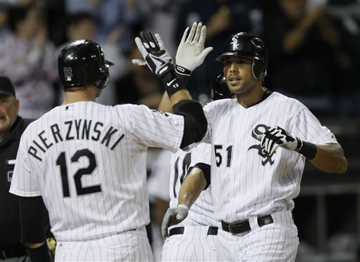 Chicago White Sox's Alex Rios (51) is greeted at home by A.J. Pierzynski, after Rios hit a three-run home run off Detroit Tigers starting pitcher Rick Porcello, Dewayne Wise and Paul Konerko scored on the home run, which was hit in the sixth inning of a baseball game Monday, Sept. 10, 2012, in Chicago. Pierzynsk followed with a solo shot. (AP Photo/Charles Rex Arbogast)