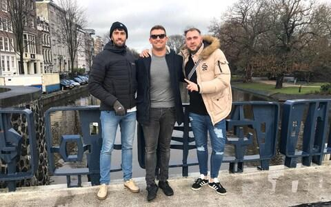 Andrew McMath (centre) organised the trip to Sofia for himself and his friends, including Rob Spray (right)