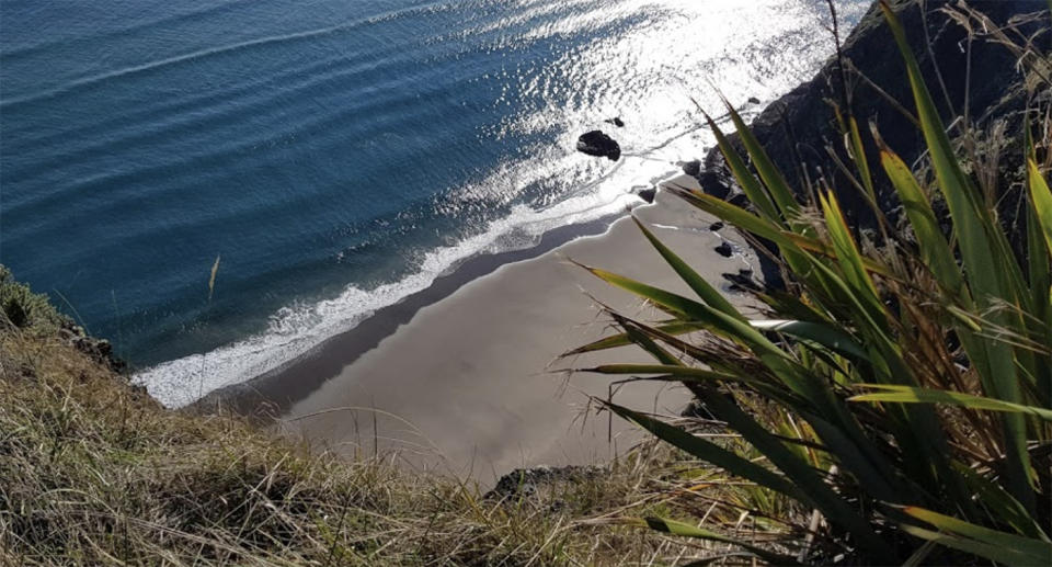 Mercer Bay beach is photographed from the top of one of the cliffs surrounding the beach.