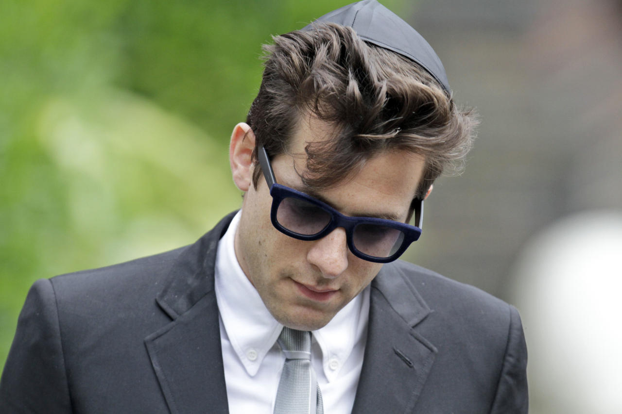 "British musician Mark Ronson, leaves Golders Green Crematorium after attending the funeral of Amy Winehouse in north London, Tuesday, July 26, 2011 . The soul diva, who had battled alcohol and drug addiction, was found dead Saturday at her London home. She was 27. Ronson produced her multi-award winning album ""Back to Black"". (AP Photo/Lefteris Pitarakis)"