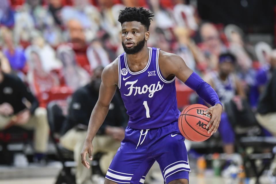 TCU's Mike Miles (1) controls the ball during the first half of an NCAA college basketball game against Texas Tech in Lubbock, Texas, Tuesday, March 2, 2021. (AP Photo/Justin Rex)