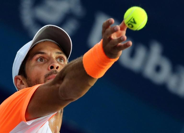 Fernando Verdasco serves against Robin Haase in the semi-finals of the Dubai Tennis Championships on March 3, 2017