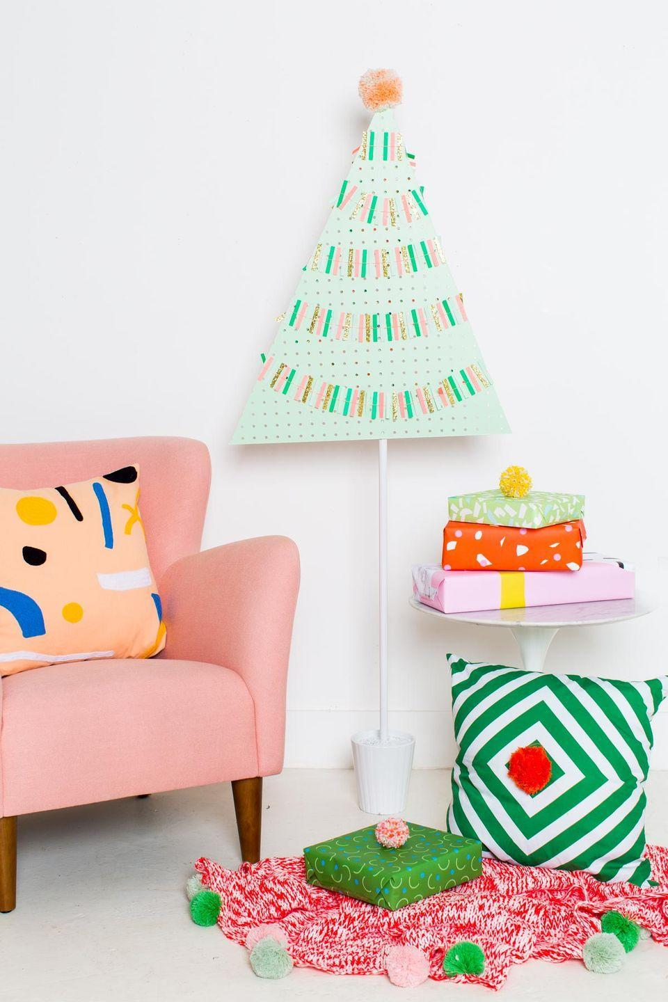"<p>This is a scene straight out of Whoville. Not only is this pegboard tree totally adorable, but it eliminates all the post-Christmas clean-up.</p><p>Get the tutorial at <a href=""https://sugarandcloth.com/diy-pegboard-christmas-tree/"" rel=""nofollow noopener"" target=""_blank"" data-ylk=""slk:Sugar & Cloth"" class=""link rapid-noclick-resp"">Sugar & Cloth</a>.</p>"
