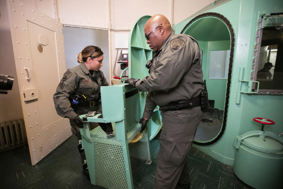 FILE — In this March 13, 2019, file photo provided by the California Department of Corrections and Rehabilitation a chair is removed from the death penalty chamber at San Quentin State Prison in San Quentin, Calif. California's top court has rejected an attempt to make it harder to impose the death penalty. The Supreme Court ruled Thursday, Aug. 26, 2021 in favor of the current system where jurors need not unanimously agree on aggravating factors used to justify the punishment. (California Department of Corrections and Rehabilitation via AP, File)
