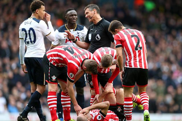 Keeping cool: Dele Alli gets a word from referee Andre Mariner: Tottenham Hotspur FC via Getty Images