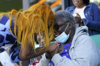Sha'Carri Richardson celebrates after winning the women's 100-meter run with grandmother Betty Harp at the U.S. Olympic Track and Field Trials Saturday, June 19, 2021, in Eugene, Ore. (AP Photo/Ashley Landis)