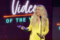 """Carrie Underwood accepts the award for video of the year for """"Hallelujah"""" at the CMT Music Awards at the Bridgestone Arena on Wednesday, June 9, 2021, in Nashville, Tenn. (AP Photo/Mark Humphrey)"""