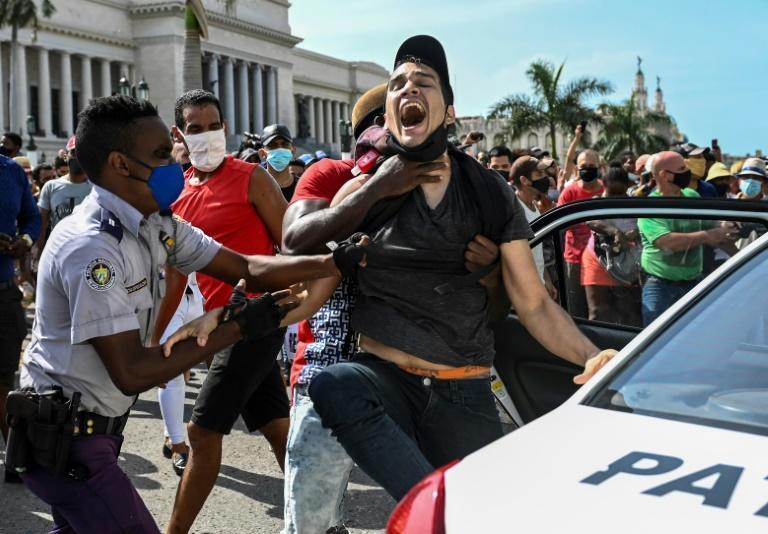 A man is arrested during a demonstration against the government of Cuban President Miguel Diaz-Canel in Havana on July 11, 2021