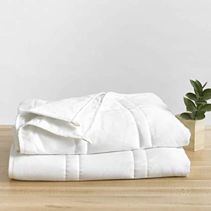 """<h3>Baloo Weighted Blanket</h3><br>This eco-friendly, soft-cotton style is double quilted and filled with lead-free glass beads. — the Amazon's Choice buy is available in 12 to 15 and 20 lb. weights. <br><br><strong>The hype:</strong> 4.6 out of 5 stars and 405 reviews on <a href=""""https://www.amazon.com/Baloo-Weighted-Eco-Friendly-Chemical-Free-Lead-Free/dp/B07N442PLC"""" rel=""""nofollow noopener"""" target=""""_blank"""" data-ylk=""""slk:Amazon"""" class=""""link rapid-noclick-resp"""">Amazon</a><br><br><strong>What they're saying: </strong>""""This is an outstanding quality weighted blanket. I did TONS of research before settling on this one. I found out who the owner of the company is and was impressed with her <a href=""""https://balooliving.com/pages/about-us"""" rel=""""nofollow noopener"""" target=""""_blank"""" data-ylk=""""slk:company mission and production process"""" class=""""link rapid-noclick-resp"""">company mission and production process</a>. Initially, I only wanted a blanket but got to support an amazing company as well. Win-win. FYI: There are multiple features that make this blanket superior. The blanket can be washed! The glass filling is evenly distributed and silent. The weight doesn't shift at all. The material is the same as organic. The material breathes and I don't get hot."""" <em>– KC, Amazon reviewer </em><br><br><strong>baloo</strong> Weighted Blanket, 15 lbs, 60x80 inches, $, available at <a href=""""https://amzn.to/2MnSb5B"""" rel=""""nofollow noopener"""" target=""""_blank"""" data-ylk=""""slk:Amazon"""" class=""""link rapid-noclick-resp"""">Amazon</a>"""