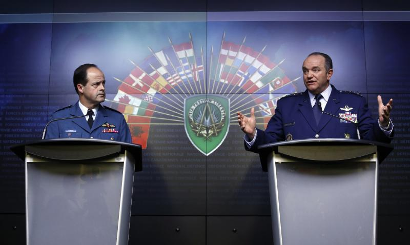 NATO Supreme Allied Commander Europe and Commander of the U.S. European Command General Philip Breedlove (R) speaks during a news conference with Canada's Chief of Defence Staff General Tom Lawson at the National Defence headquarters in Ottawa May 6, 2014. NATO will have to consider permanently stationing troops in eastern Europe as a result of the increased tension between Russia and Ukraine, the alliance's top military commander Breedlove said on Tuesday. REUTERS/Chris Wattie (CANADA - Tags: POLITICS MILITARY)