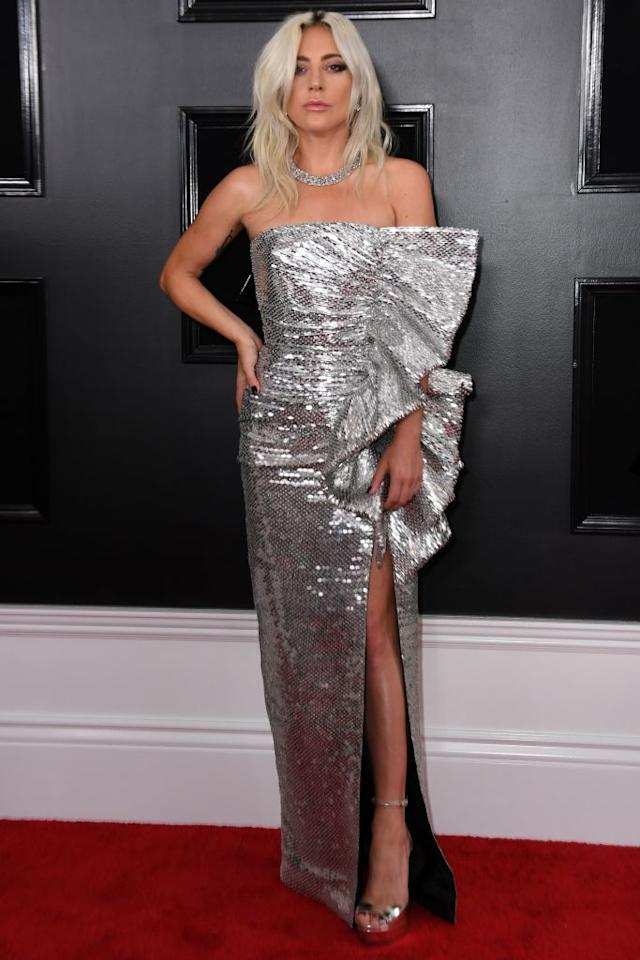 "<p>Lady Gaga was every bit the star as she hit the red carpet, ahead of a big night for her song ""Shallow,"" from <em>A Star Is Born</em>, wearing a standout silver dress. </p>"