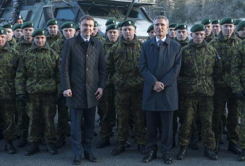 NATO Secretary General Jens Stoltenberg (3R) and Estonian Prime Minister Taavi Roivas (L) visit the Amari air base that hosts the defence alliance's air policy mission over the Baltic states in Amari, Estonia on November 20, 2014 (AFP Photo/Raigo Pajula)
