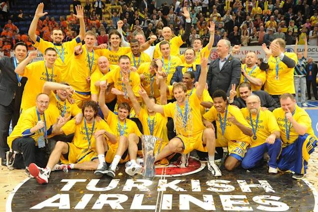 BC Khimki's players celebrate with their trophy after winning the Eurocup final basketball match between BC Khimki and Valencia in Khimki, outside Moscow on April 15, 2012. BC Khimki won 77-68. AFP PHOTO / KIRILL KUDRYAVTSEV