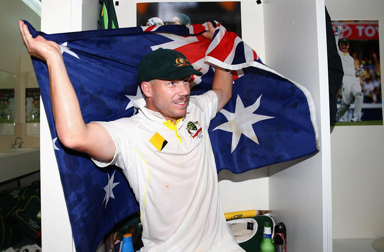 PERTH, AUSTRALIA - DECEMBER 17:  David Warner of Australia celebrates victory in the change rooms during day five of the Third Ashes Test Match between Australia and England at WACA on December 17, 2013 in Perth, Australia.  (Photo by Ryan Pierse/Getty Images)