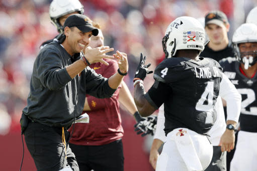 Iowa State head coach Matt Campbell, left, celebrates with running back Johnnie Lang (4) after Lang scored on a 3-yard touchdown run during the second half of an NCAA college football game against TCU, Saturday, Oct. 5, 2019, in Ames, Iowa. Iowa State won 49-24. (AP Photo/Charlie Neibergall)