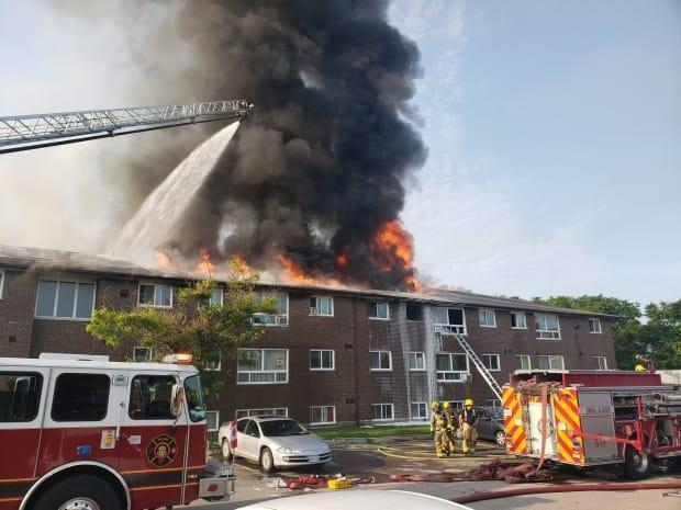 Firefighters on scene of an Oshawa apartment fire. Police are asking people to avoid the area. (Durham Regional Police Service - image credit)