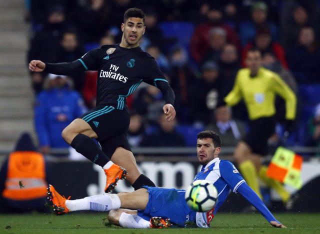 Real Madrid's, Marco Asensio, left, vies for the ball with Espanyol's Aaron Martin during the Spanish La Liga soccer match between Espanyol and Real Madrid at RCDE stadium in Cornella Llobregat, Spain, Tuesday, Feb. 27, 2018. (AP Photo/Manu Fernandez)