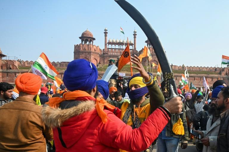 Protesters shout slogans in front of the Red Fort, the former seat of power for the Mughal empire