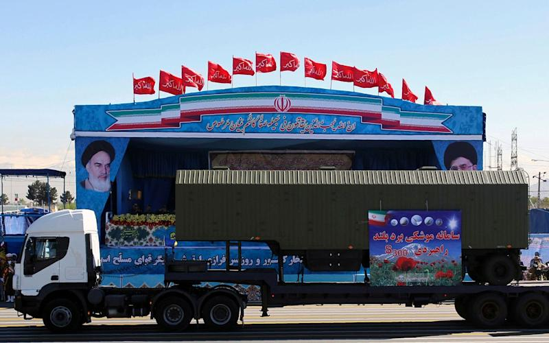 An Iranian military truck carries parts of the S300 missile system during the Army Day parade in Tehran - AFP or licensors