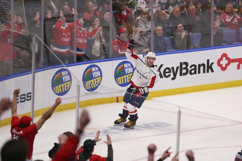 Washington Capitals forward Alex Ovechkin (8) celebrates a goal by teammate Dmitry Orlov during the third period of an NHL hockey game against the Buffalo Sabres, Monday, March 9, 2020, in Buffalo, N.Y. (AP Photo/Jeffrey T. Barnes)