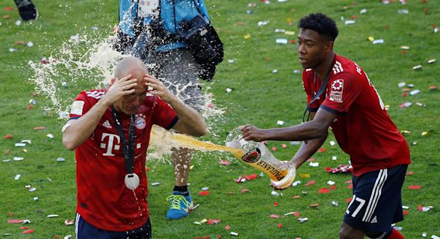 Soccer Football - Bundesliga - Bayern Munich v VfB Stuttgart - Allianz Arena, Munich, Germany - May 12, 2018 Bayern Munich's David Alaba celebrates winning the Bundesliga by pouring beer over Arjen Robben REUTERS/Michaela Rehle DFL RULES TO LIMIT THE ONLINE USAGE DURING MATCH TIME TO 15 PICTURES PER GAME. IMAGE SEQUENCES TO SIMULATE VIDEO IS NOT ALLOWED AT ANY TIME. FOR FURTHER QUERIES PLEASE CONTACT DFL DIRECTLY AT + 49 69 650050