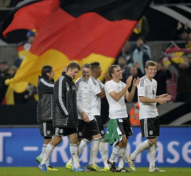 Germany players celebrate qualifying for the 2014 World Cup after the Group C qualifying soccer match between Germany and Ireland in Cologne, Germany, Friday, Oct. 11, 2013. (AP Photo/Martin Meissner)